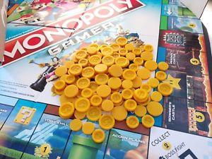 Las monedas del juego MonopolyGamer
